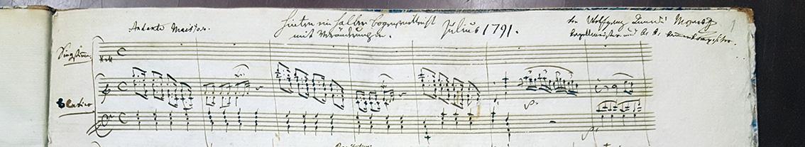 detalj från ett notblad med noter av mozart