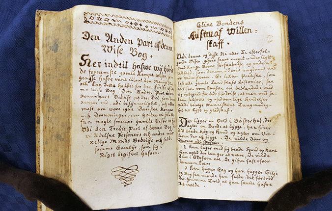 ett uppslag med handskriven text i en bok