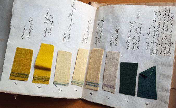 pappersark med fastlimmade tygprover i gula nyanser