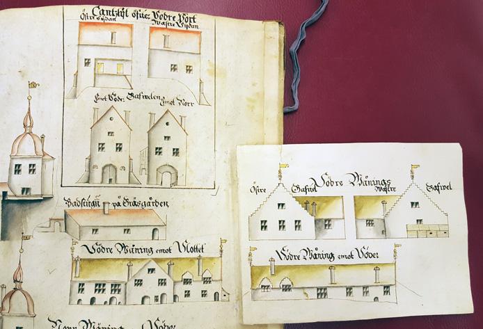detalj av en ritning med utvikbara flikar som visar förlängning av byggnader och torn
