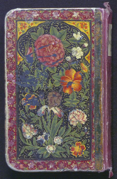 den främre pärmen med färggladsa blommor mot svart botten