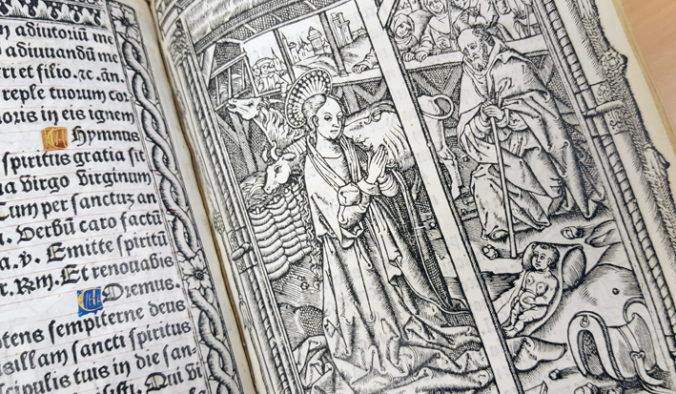 detalj från uppslag med krubbscen med Maria, Josef och Jesusbarnet