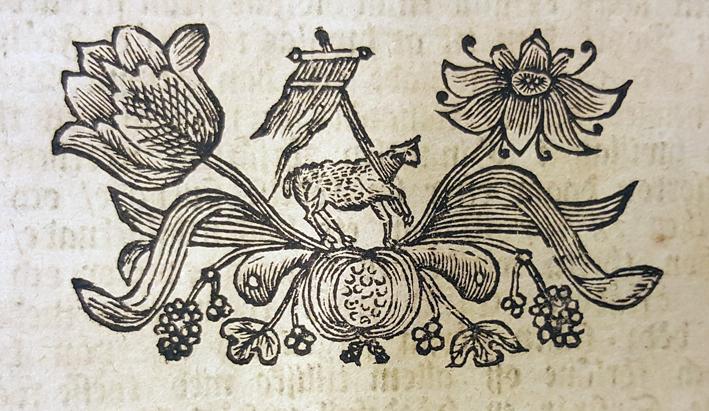 träsnittsvinjett från trycket med ett agnus dei-lamm med blommor omkring