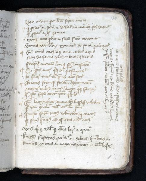 en sida ur handskriften där någon skrivit utmed kanten på pappret på höjden vid sidan om resten av texten