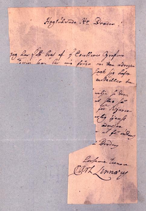 bild på ett brev som fått större delen sönderklippt och därefter klistrats på grått papper