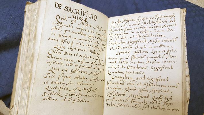 uppslag med handskrivna anteckningar