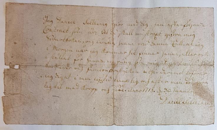 bild på avtalet skrivet i brunt bläck på papper