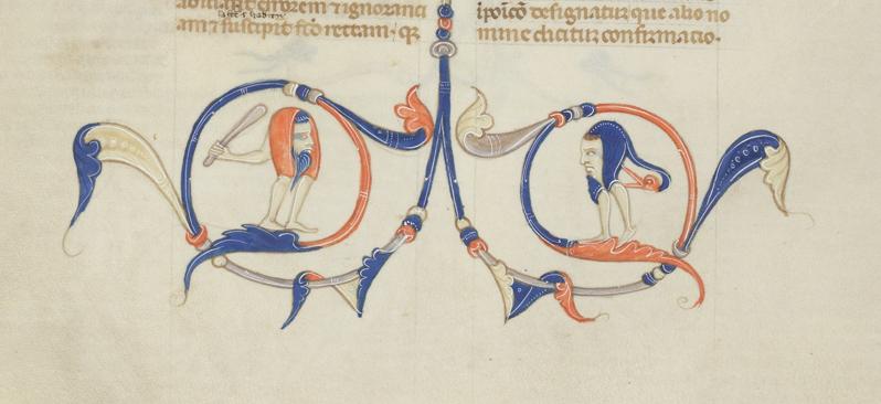 två huvuden på ben i underkanten på en handskriftssida