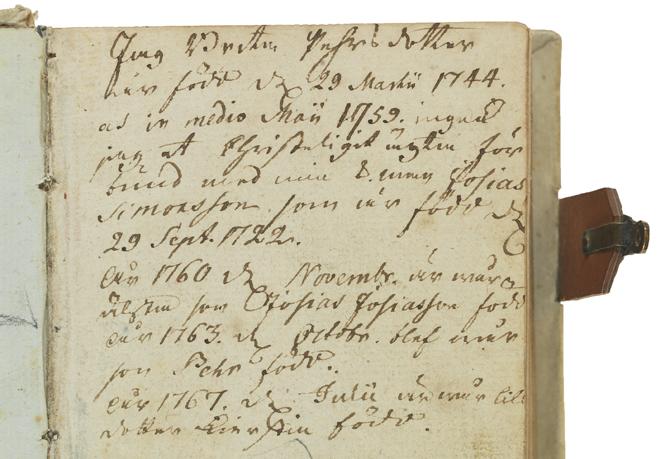 handskriven text på försättsbladet med snirklig 1700-talsstil