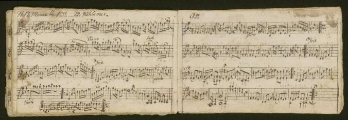 uppslag med handskrivna musiknoter