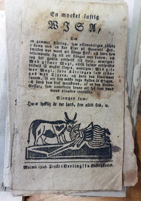 titelsidan på trycket med bilden av kvinnan och kon längst ned