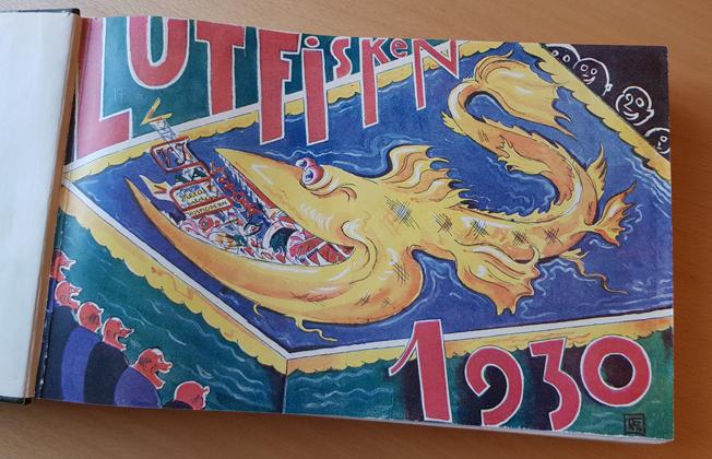 omslag med en stor gul fisk som sväljer andra för tiden populära tidskrifter