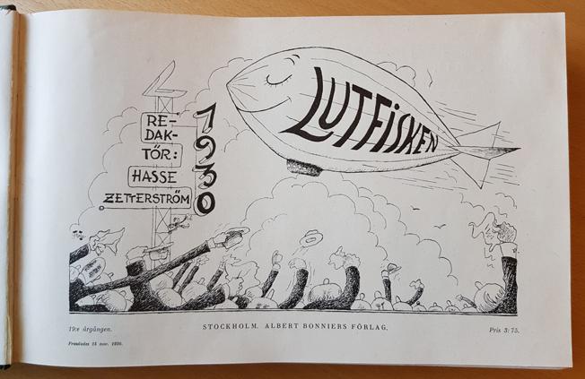 titelbladet 1930 med en lutfisk i form av en zeppelinare som folkmassa vinkar till
