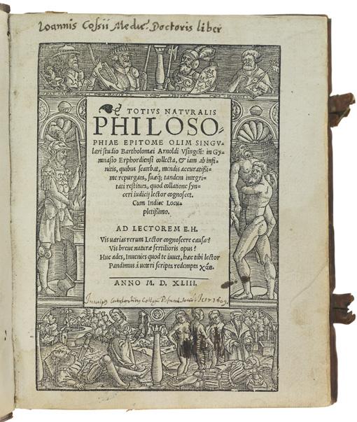 titelsida med en ram av träsnitt runt texten på sidan