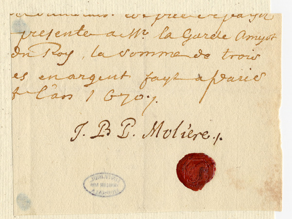 ett avklippt papper med handskriven text över namnteckning och rött sigill
