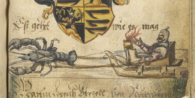en man dras i en släde dragen av en hummer