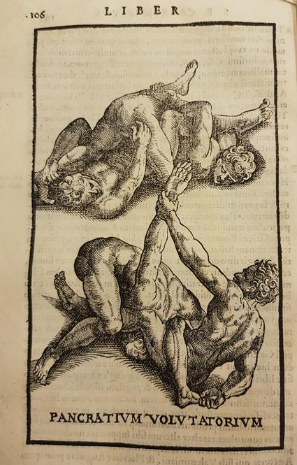 två par män brottas på marken och har fast varandra i grepp om armar och ben