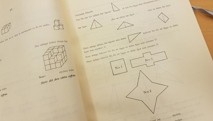 uppslag med kuber och romber som ska sorteras för att utläsa intelligensen hos lösaren