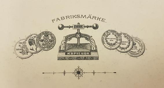 logotypen för firman, med en press i mitten och medaljer omkring