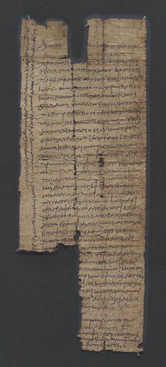 ett avlångt, trasigt papyrusfragment tättskrivet med grekisk text