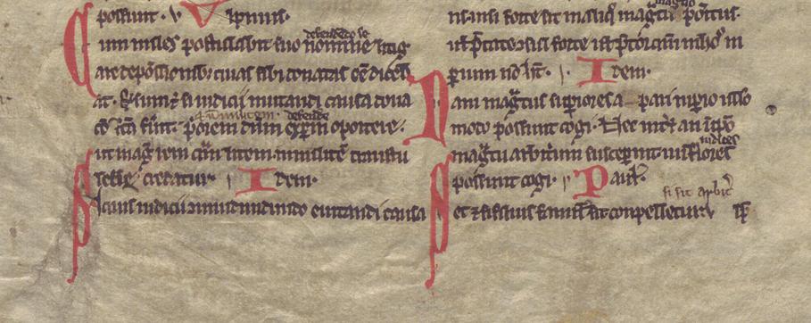 text på pergament i rött och svart